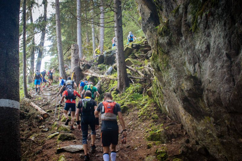 Climbing through a forest at Mont Blanc Marathon